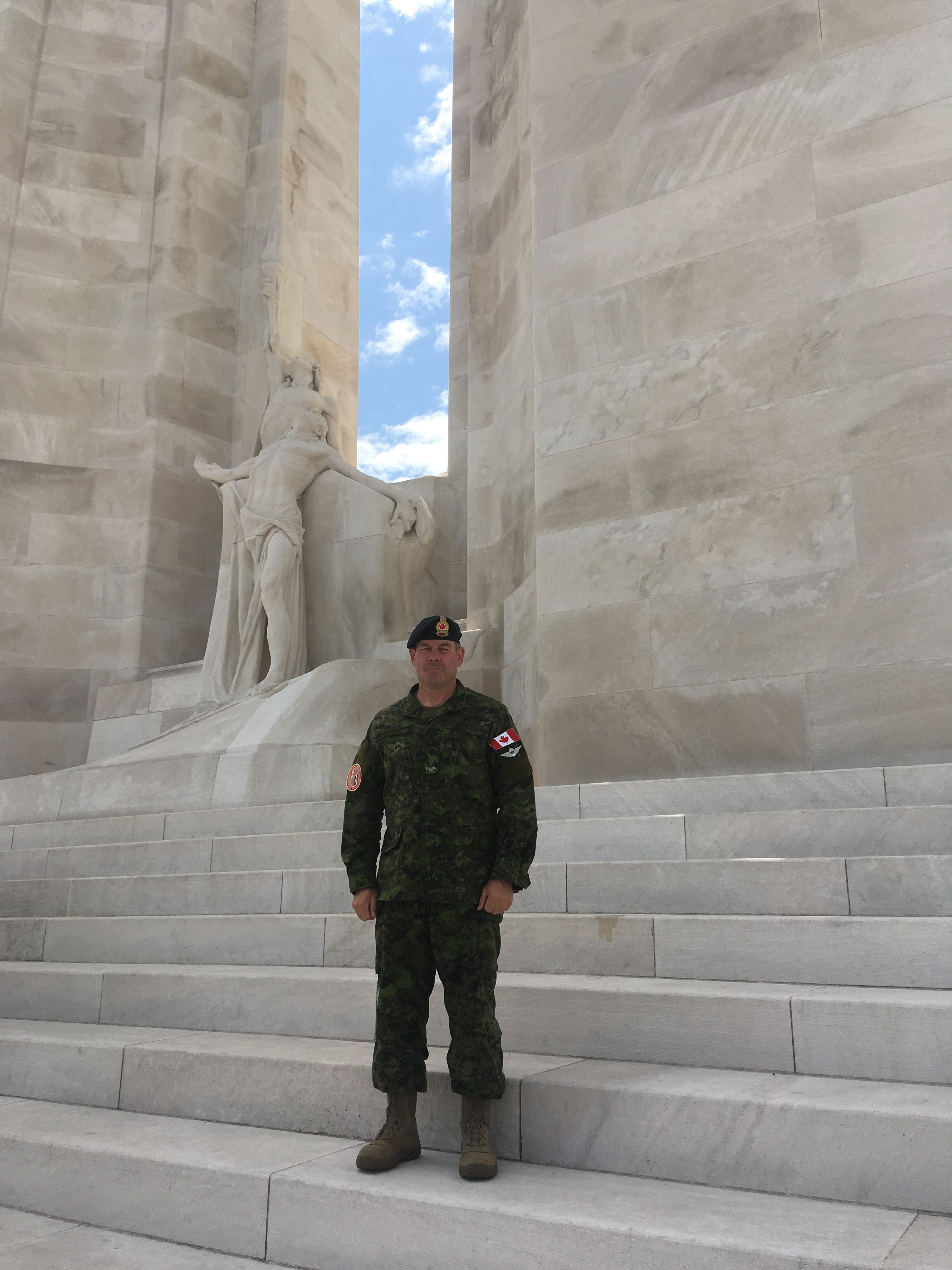 Lee Harrison poses in front of the Vimy War Memorial.