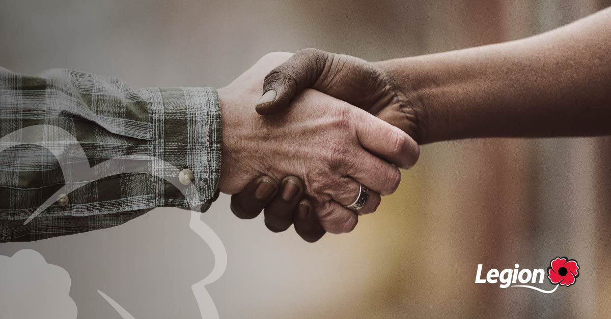 Closeup of two hands grabbing each other in a hand-shake like manner.