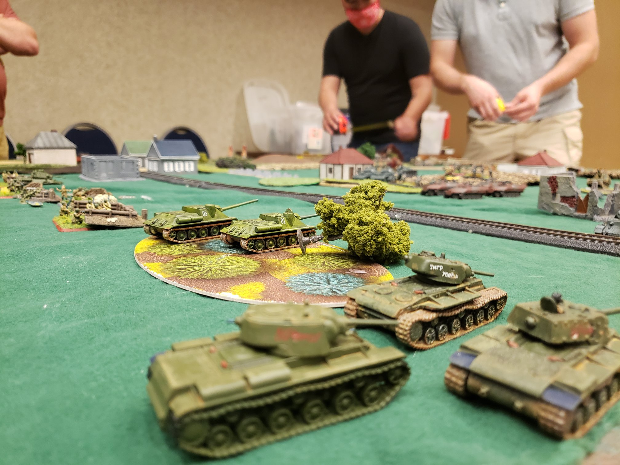Photo of table top game with tanks in the forefront.
